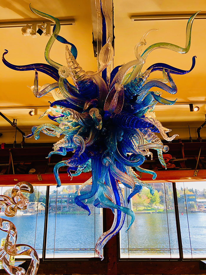 Chihuly glass sculpture with Lake Union in the background