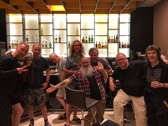 Band with promoter Steve Altit and tour manager Adrian Holmes celebrating at end of tour!