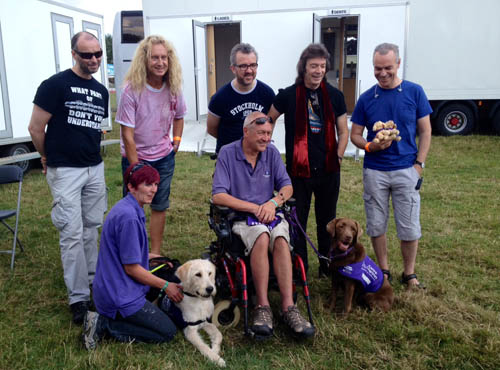 Rob, Nad, Gary, Steve and Roger with Canine Partners people and dogs who assist those who're wheelchair bound.