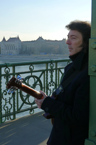 Steve playing on a bridge in Budapest for the video