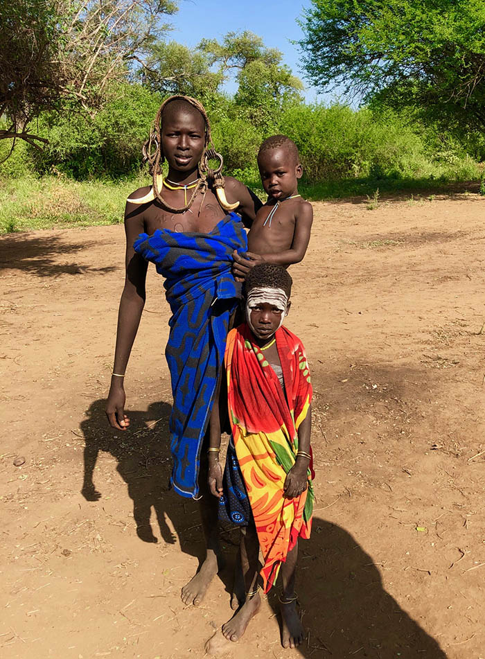 Mursi woman with children