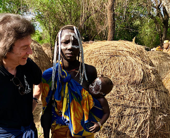 Steve with Mursi woman and child