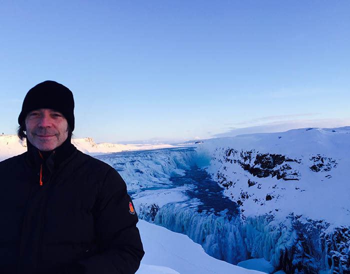 Steve at partially frozen Gullfoss waterfall, Iceland